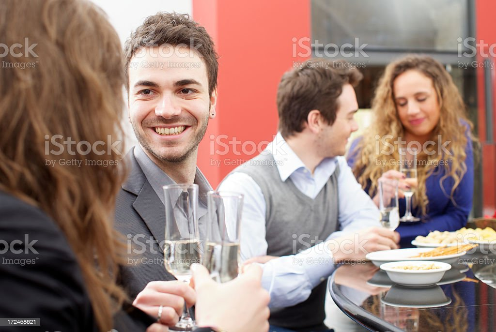 Group of friends toasting during an italian aperitif royalty-free stock photo
