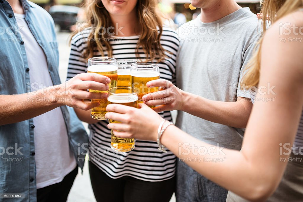 group of friends toasting with drinks for the oktoberfest stock photo