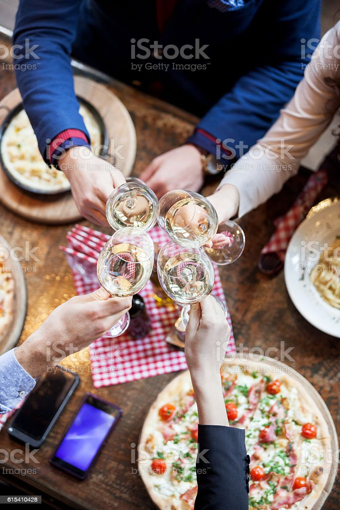 Group of friends toasting with wine stock photo