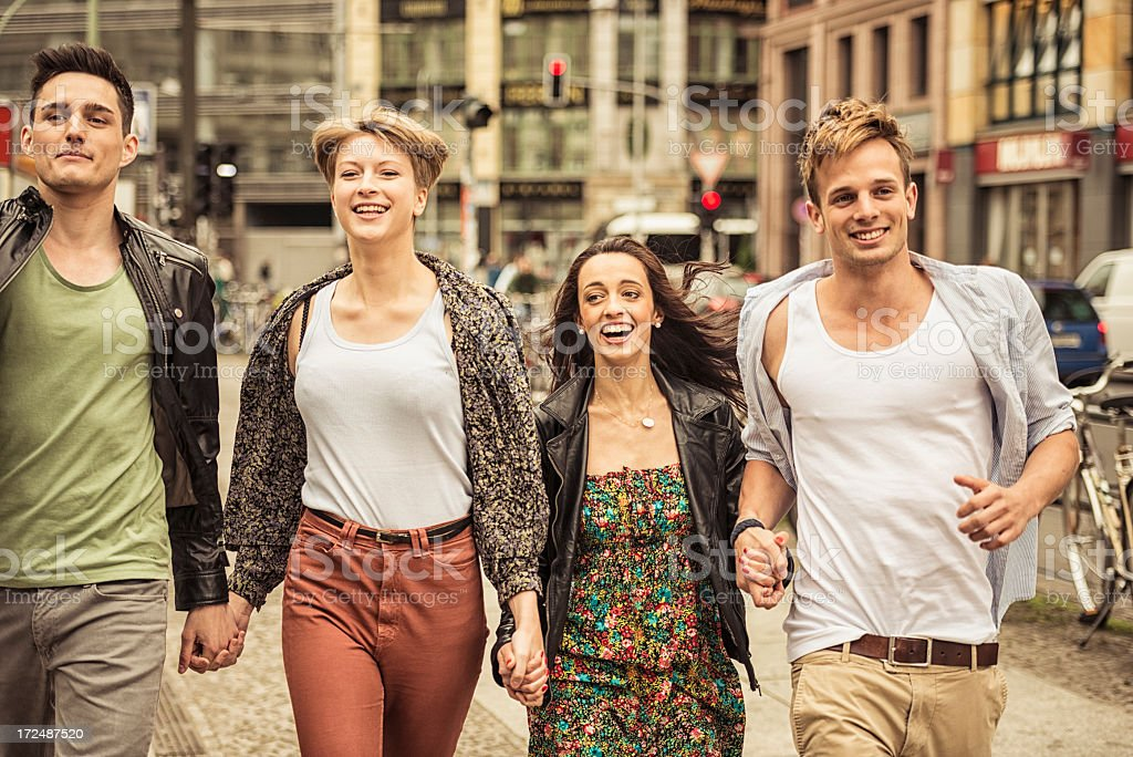 group of friends walking on the city royalty-free stock photo