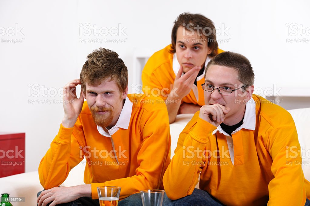 Group Of Friends Watching An Intense Match stock photo