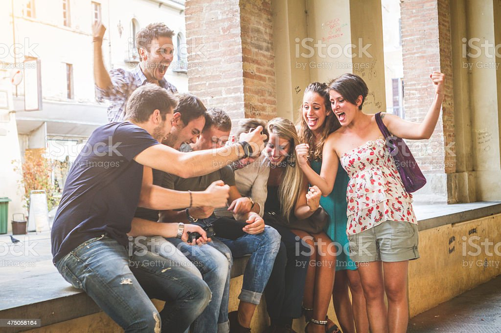Group of friends watching sport on a digital tablet stock photo