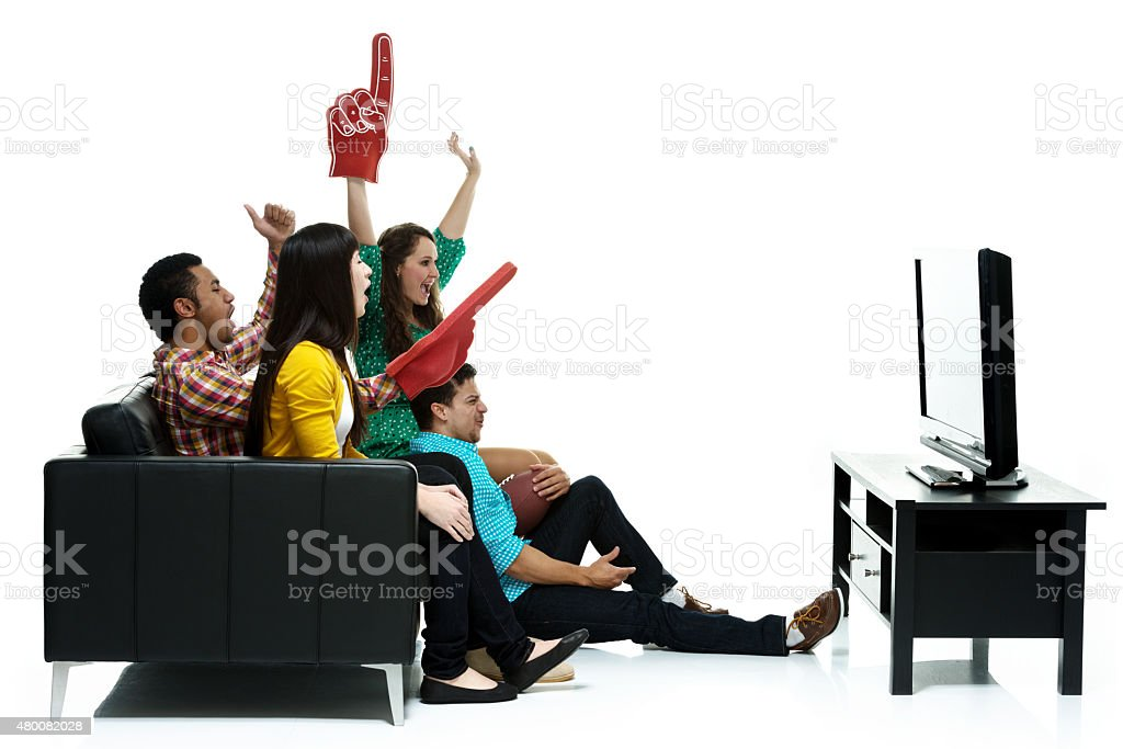 Group of friends watching television stock photo