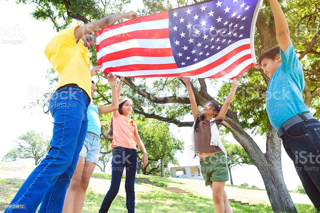 Group of friends wave American flag stock photo
