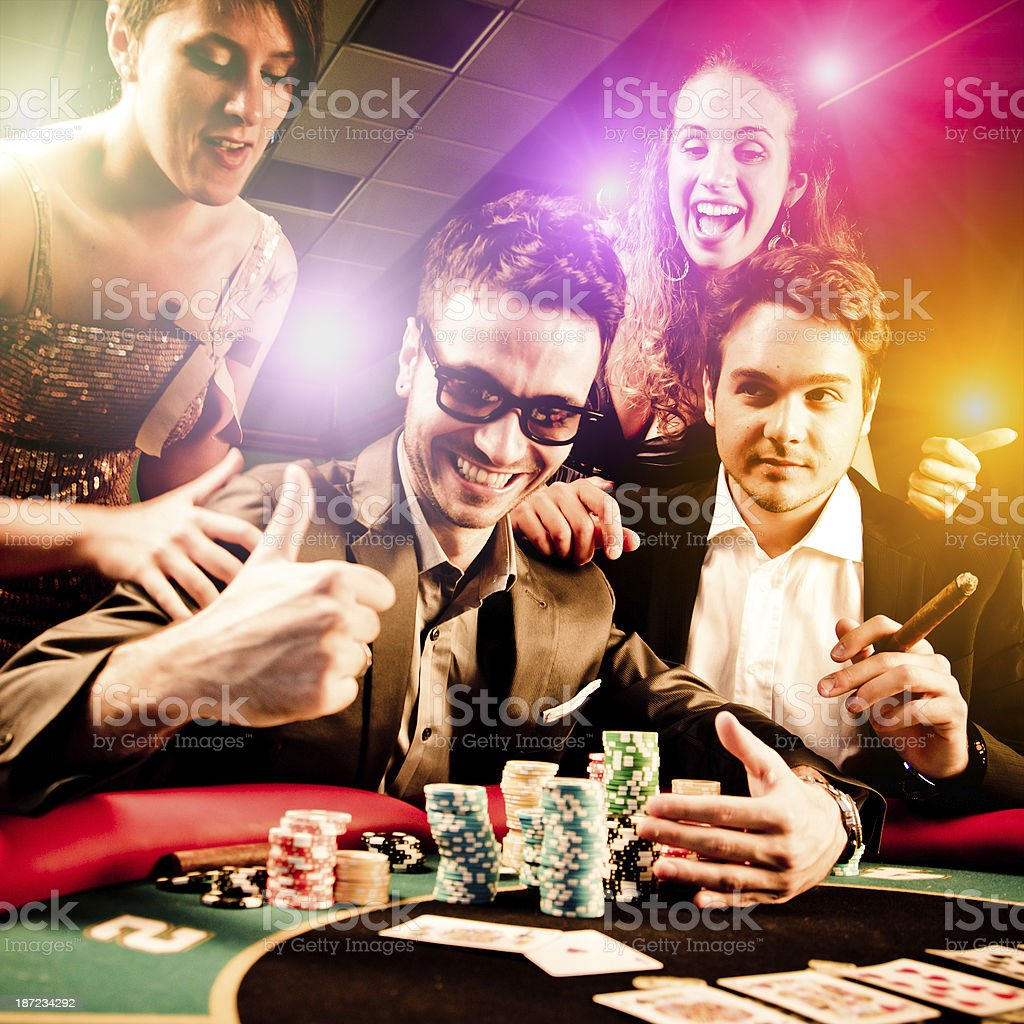 Group of friends winning at Casino stock photo