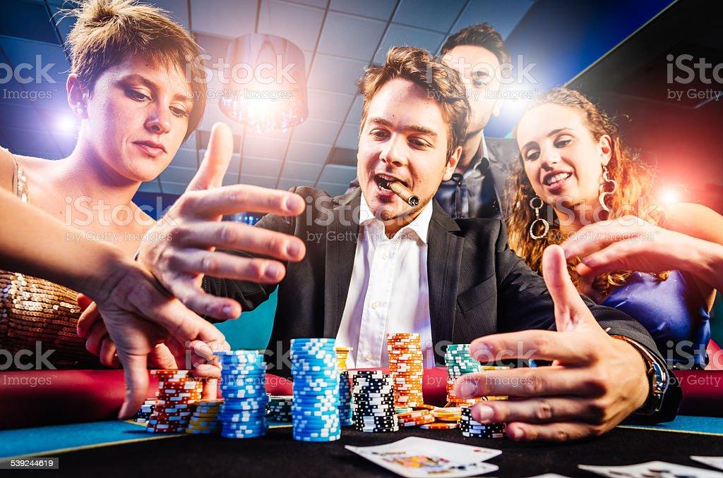 Group of friends winning at Casino stock photo