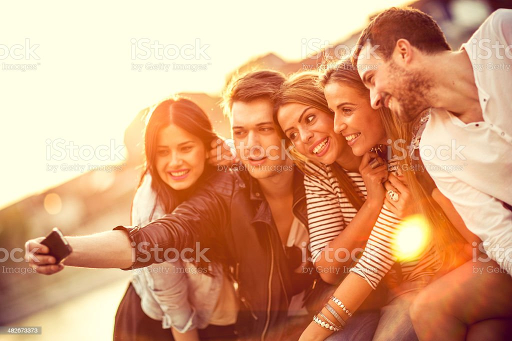 Group of friends with a smartphone royalty-free stock photo