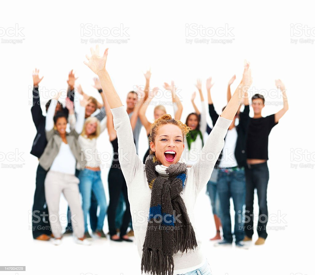 Group of friends with arms raised royalty-free stock photo
