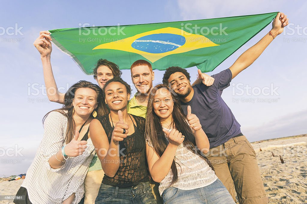 Group of Friends with Brazilian Flag at Beach stock photo