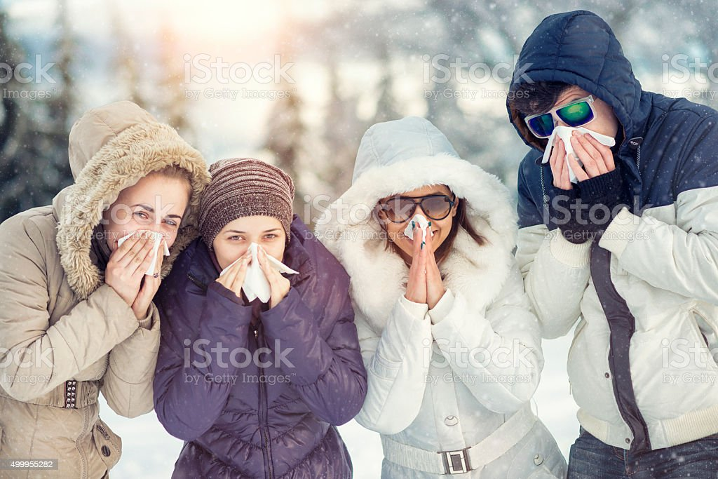 Group of Friends with Colds how Blowing Noses in Winter stock photo