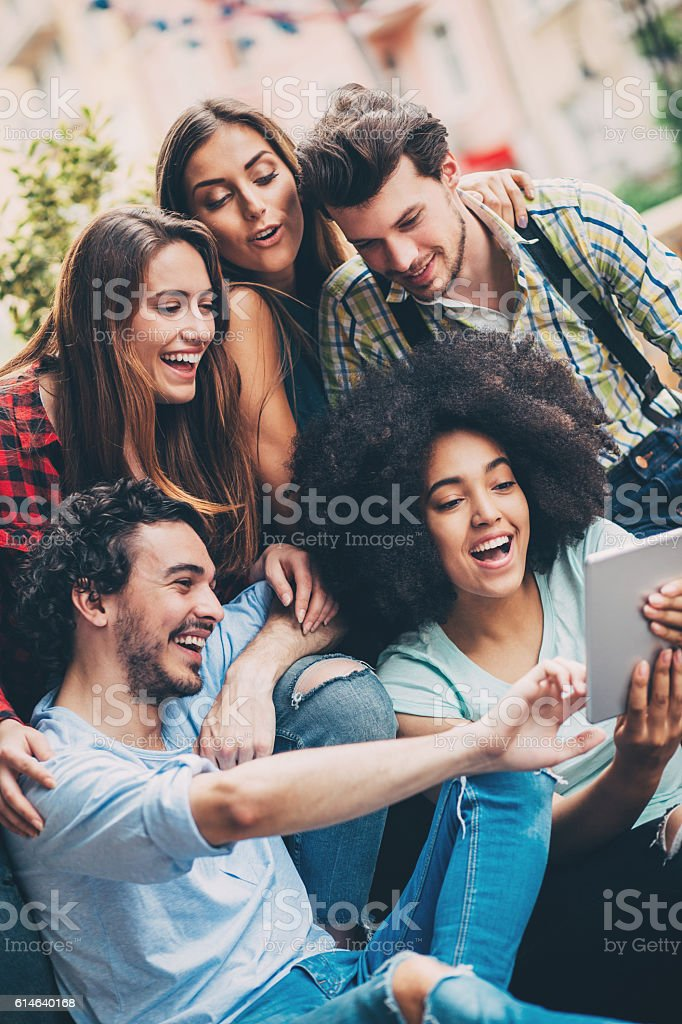 Group of friends with digital tablet stock photo