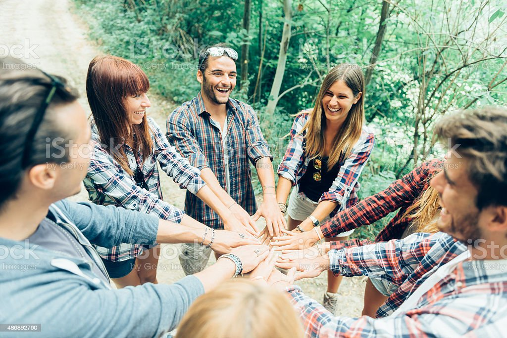 Group of Friends with Hands in Stack, Teamwork stock photo