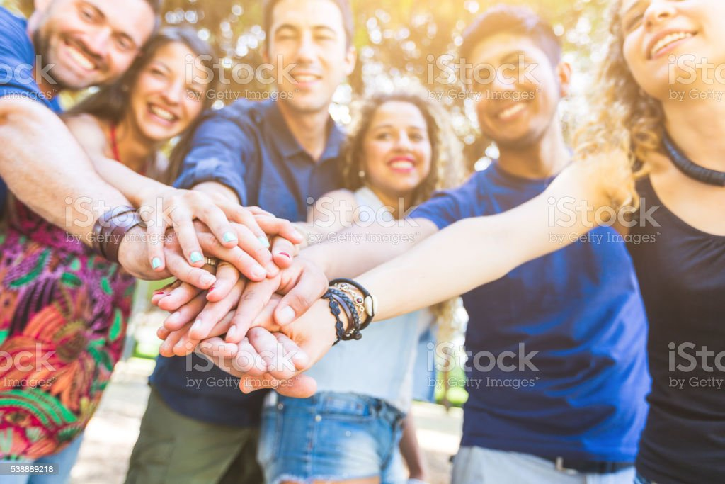 Group of friends with hands on stack stock photo
