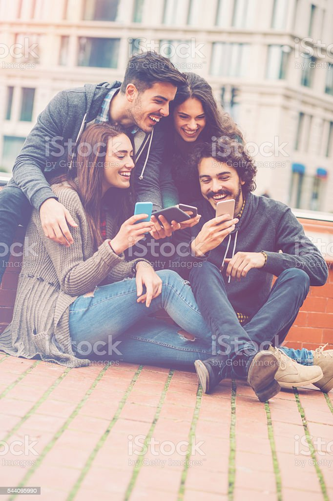 Group of friends with smart phones stock photo
