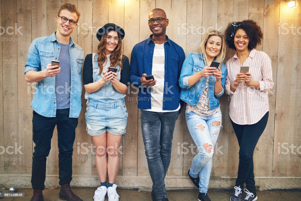 Group of friends with smartphones stock photo