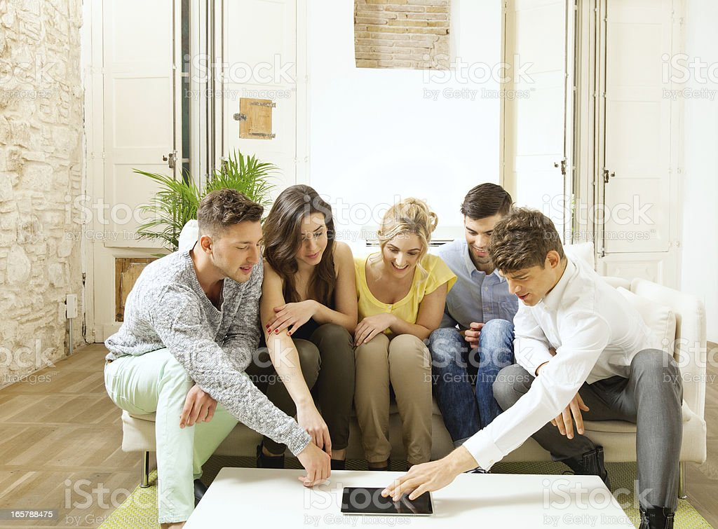 Group of friends with Ipad royalty-free stock photo