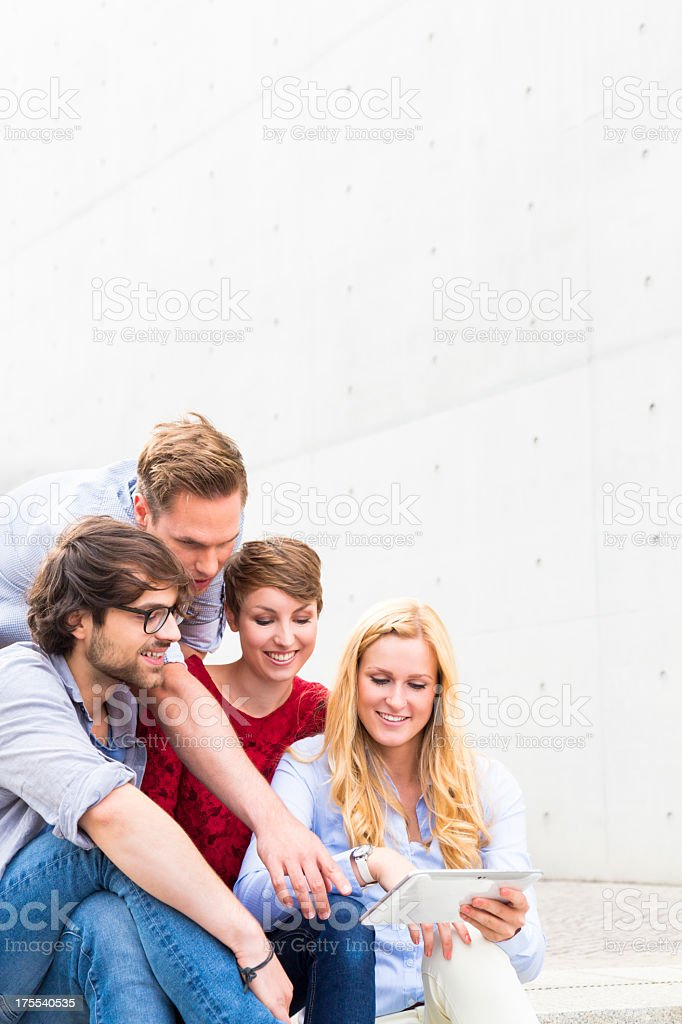 Group of friends with tablet stock photo