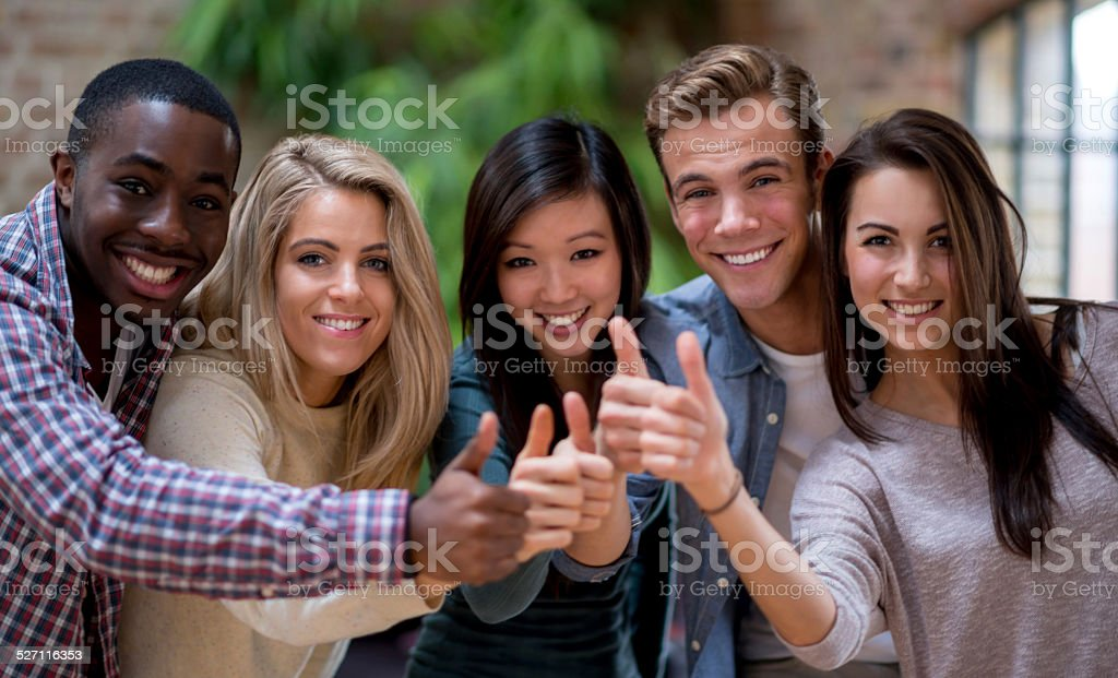 Group of friends with thumbs up stock photo