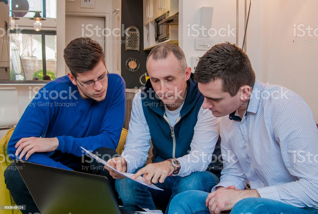 Photo of a group of friends working on some new ideas at home. Young...