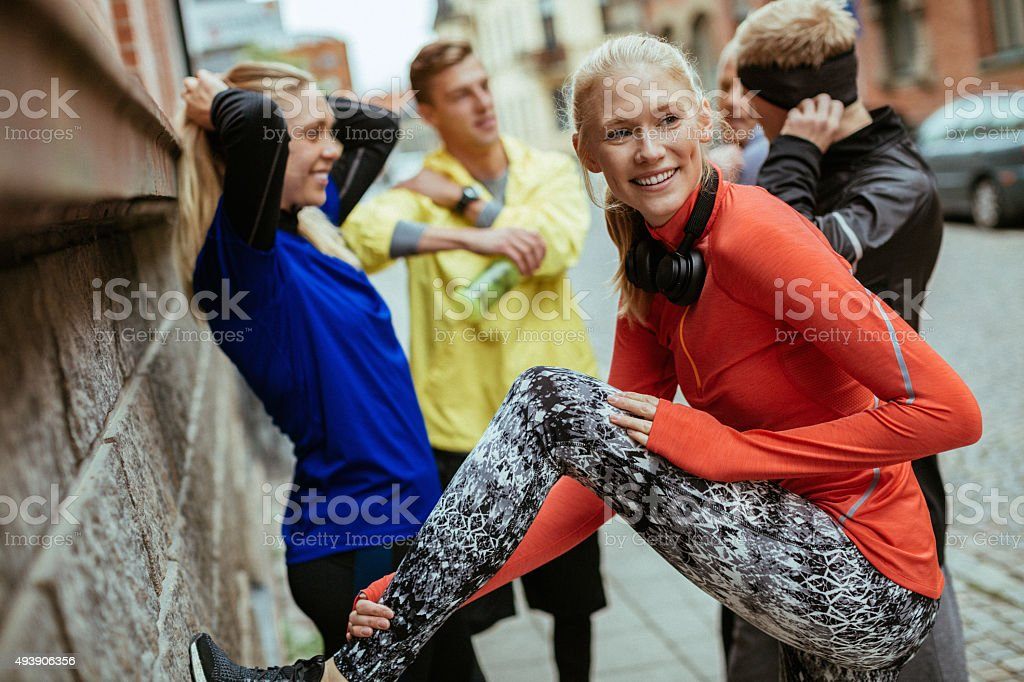 Group of friends working out together stock photo