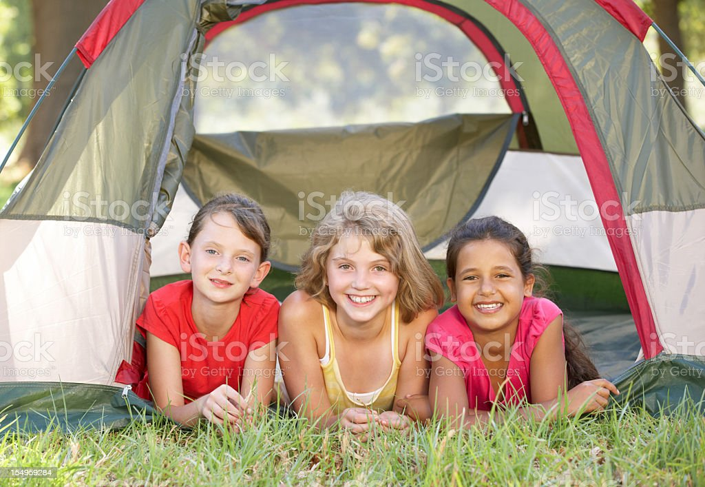 Group Of Girls Having Fun In Tent royalty-free stock photo