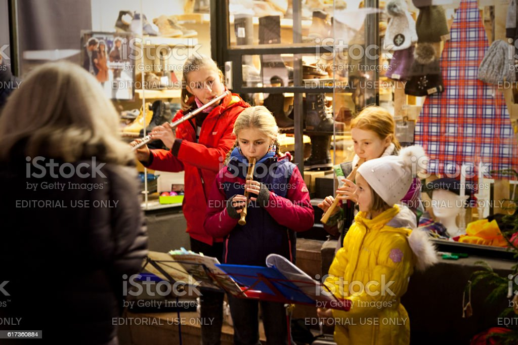 group of girls playing christmas songs stock photo