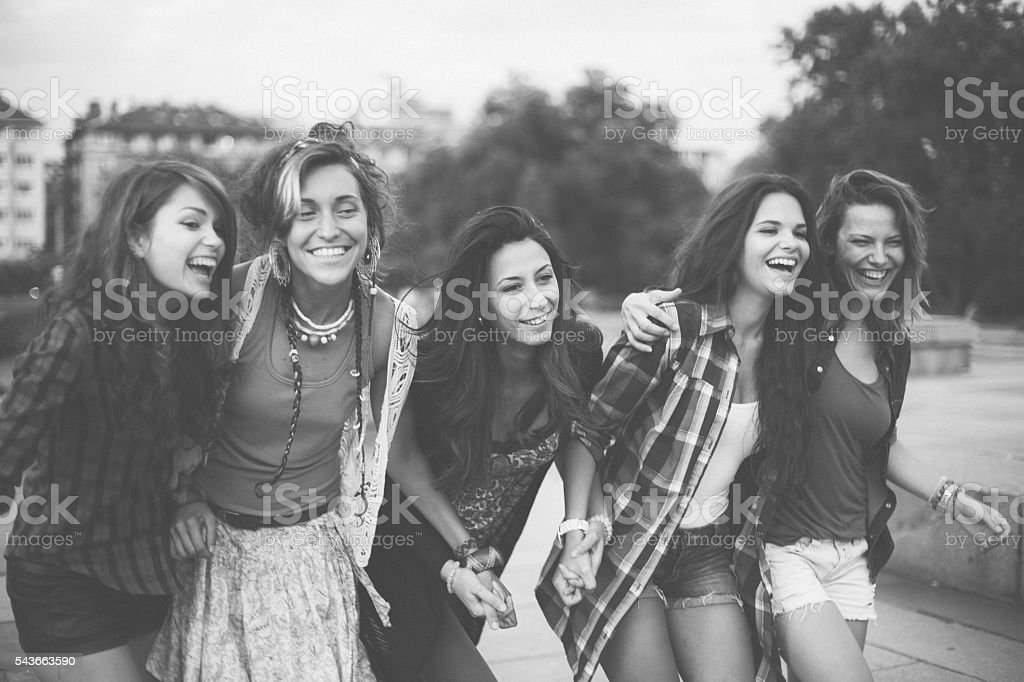 Group of girls walking in a row stock photo