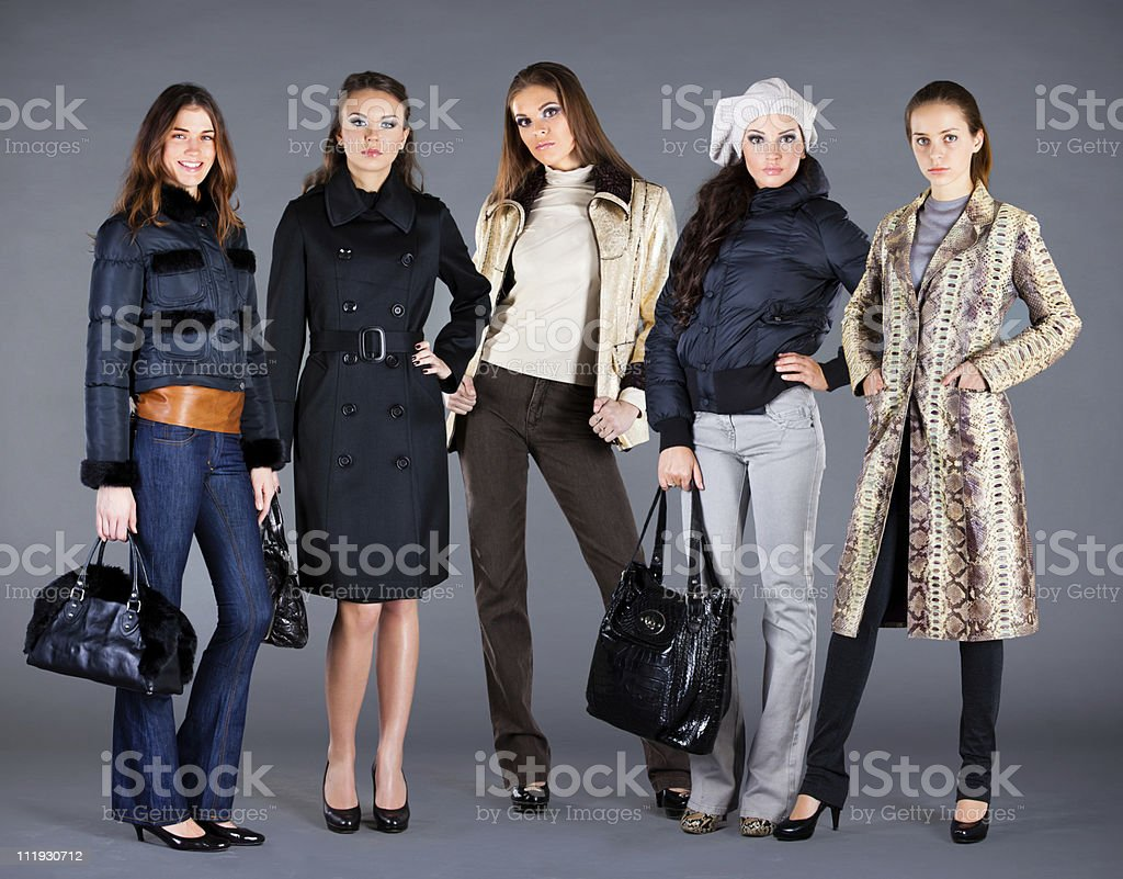 Group of girls wearing autumn winter collection clothes royalty-free stock photo