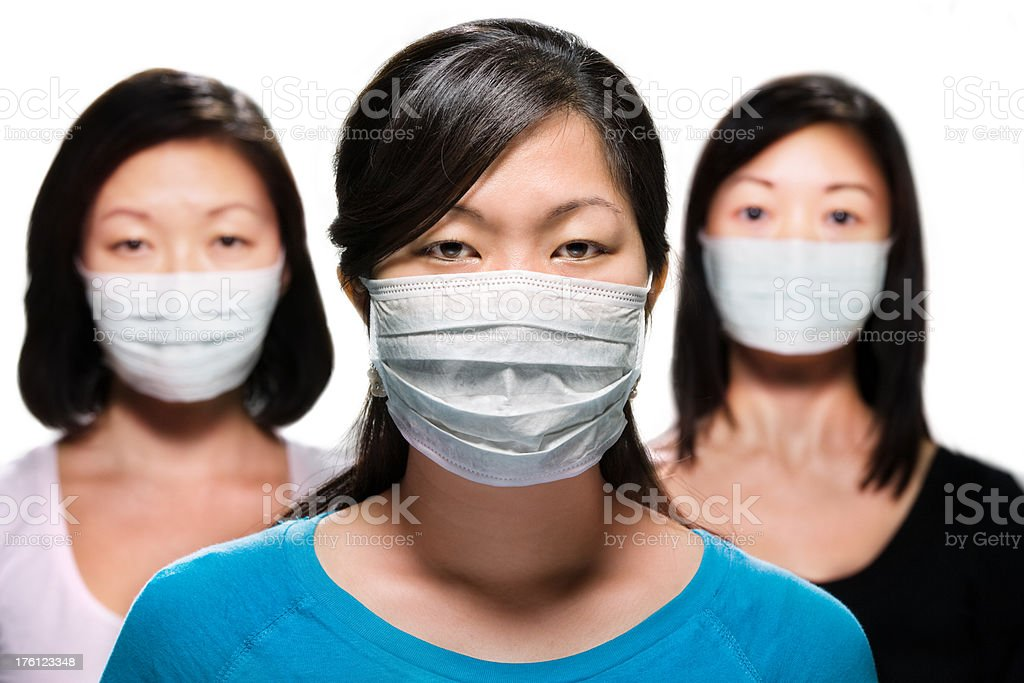 Group of girls wearing protective masks royalty-free stock photo