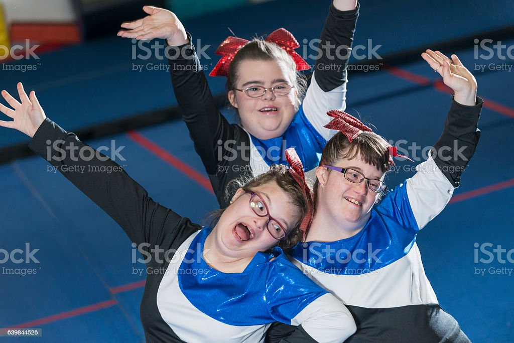 Group of girls with down syndrome on cheerleading squad stock photo