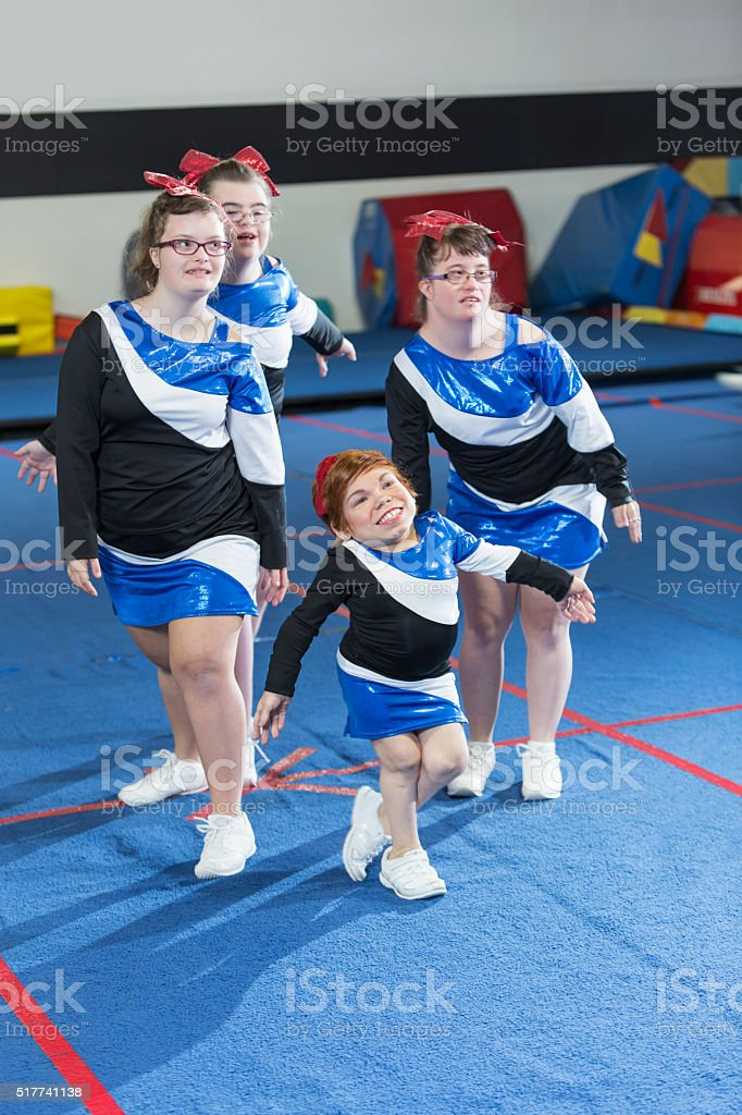 Group of girls with special needs on cheerleading squad stock photo