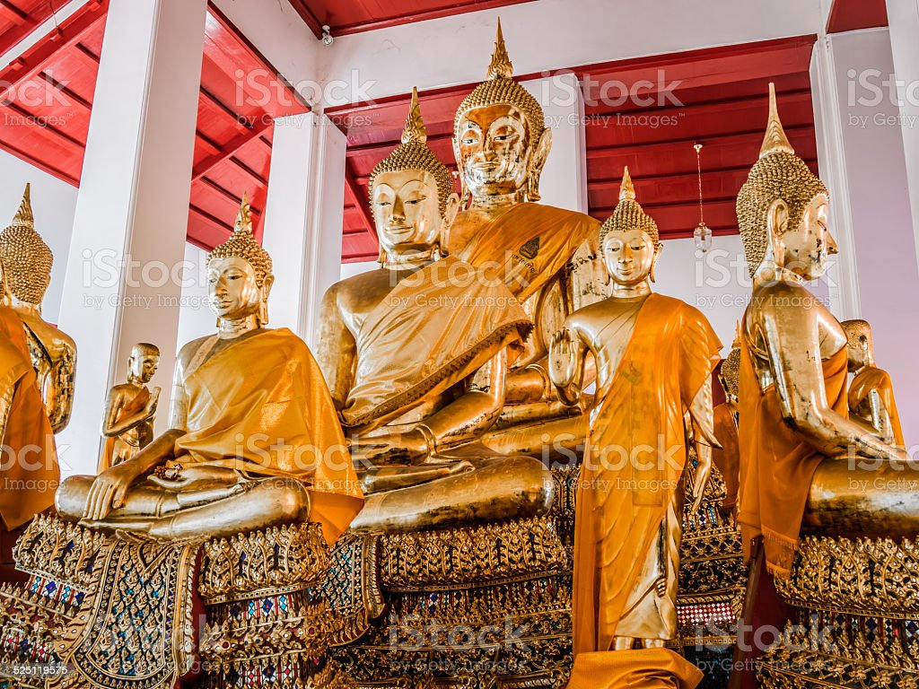 Group of golden Buddha statues. stock photo