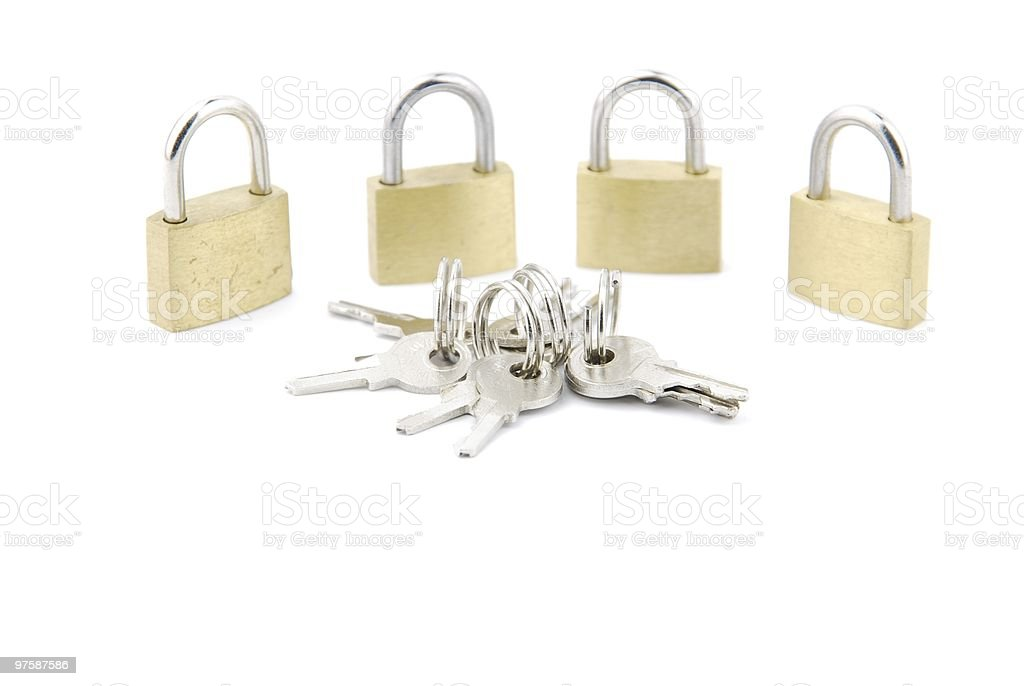 Group of golden closed padlocks with keys on white stock photo