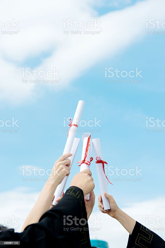 Group of graduate students holding diploma stock photo