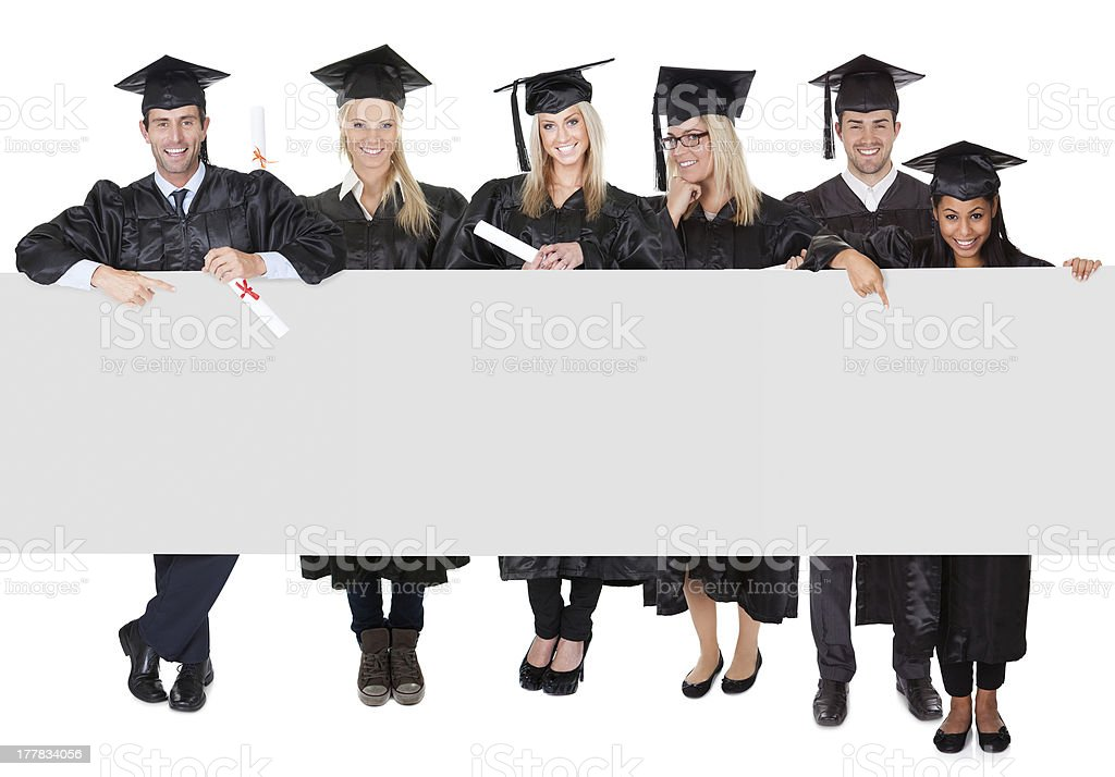 Group of graduate students presenting empty banner royalty-free stock photo