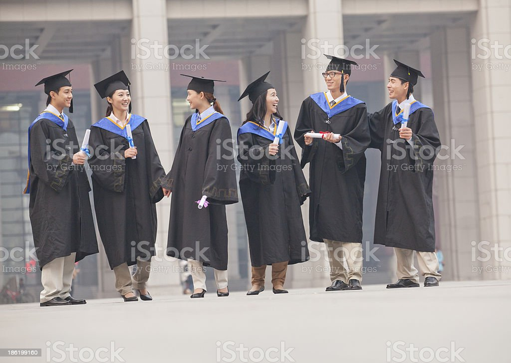 Group of Graduate Students Standing with Diplomas royalty-free stock photo