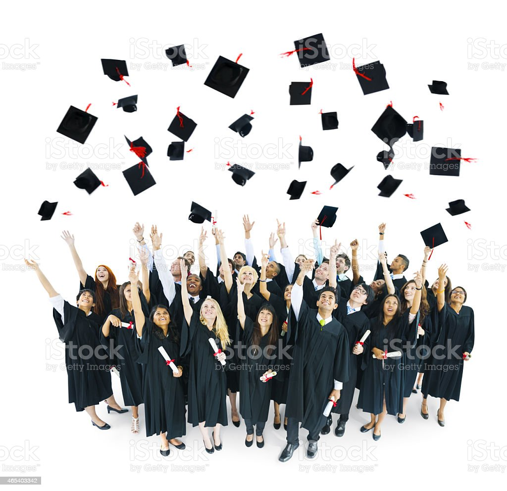 Group of graduates throwing caps in the air on a white back stock photo