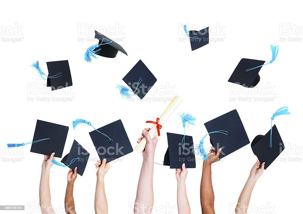Group of Graduating Student's Hands Holding and Throwing Graduatation Hats stock photo