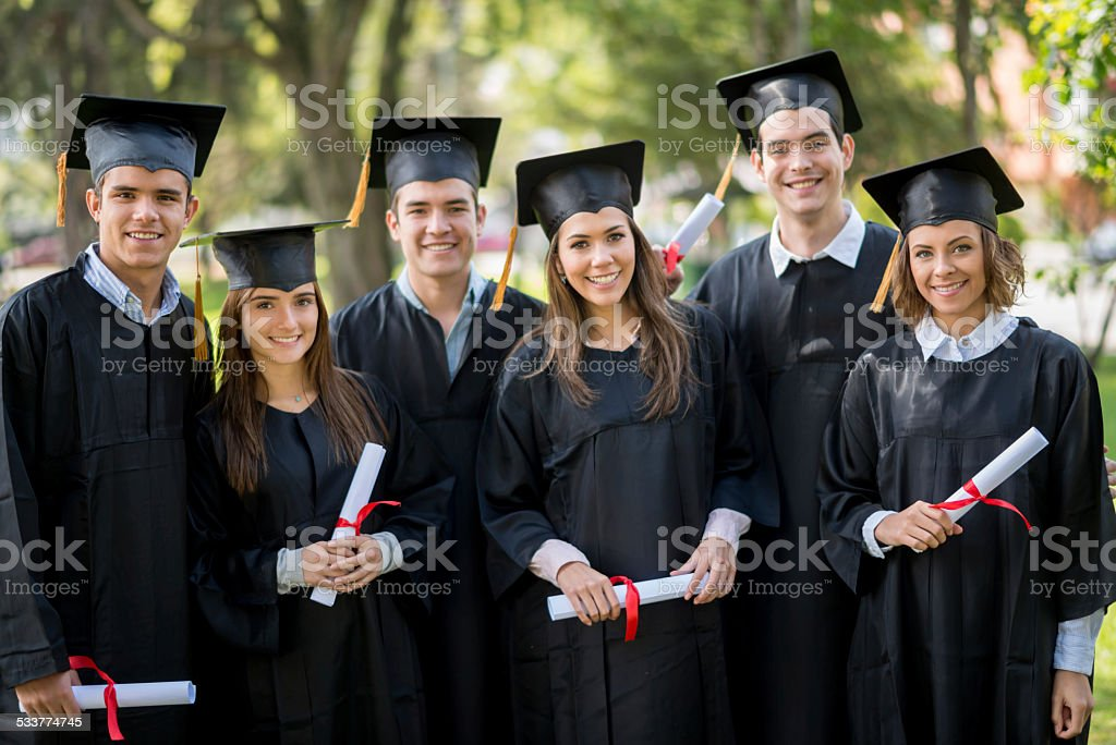 Group of graduation students stock photo