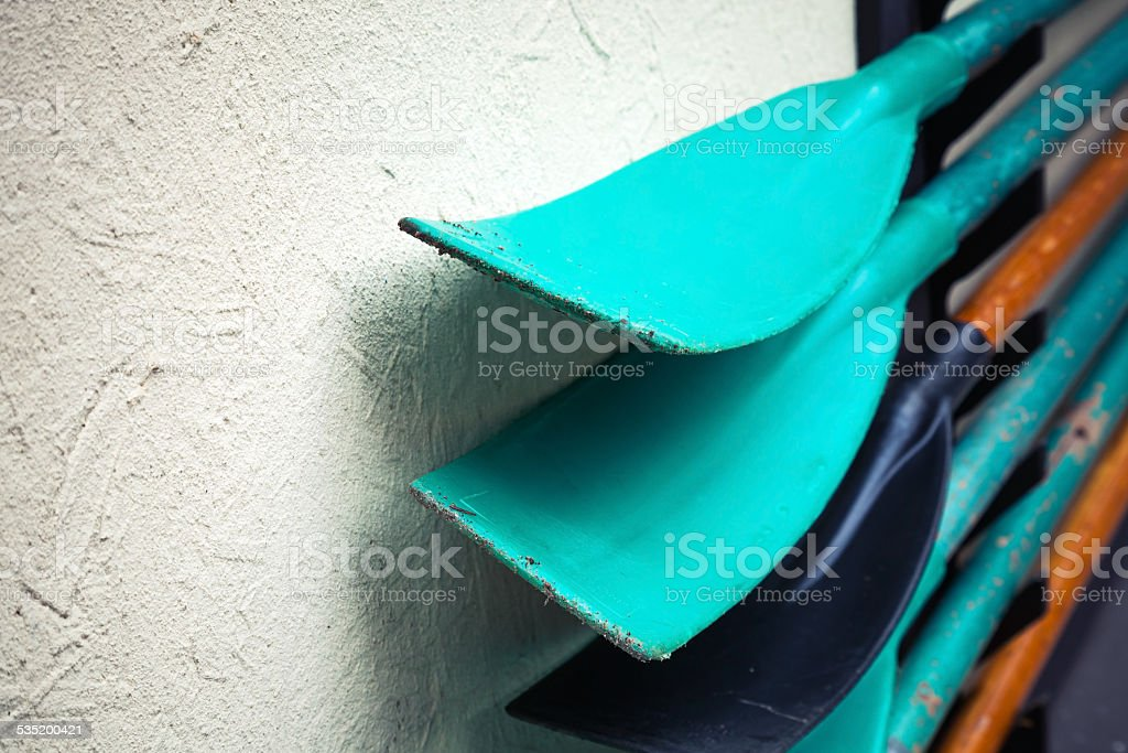 Group of green and black paddles, fragment stock photo