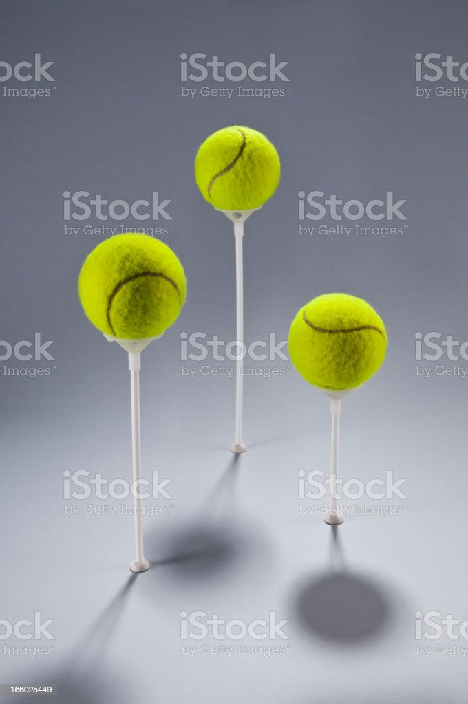 Group of green tennis balls on sticks, tournament, competition, concept royalty-free stock photo