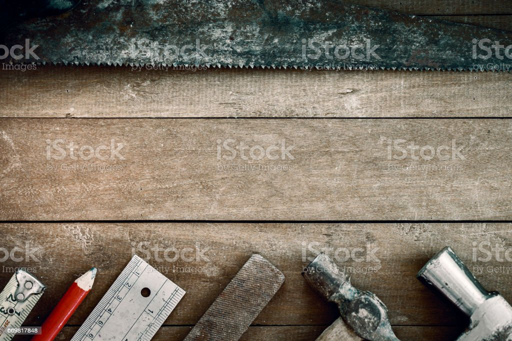 Group of grunge tools on wooden background with empty space for  text or brand. stock photo