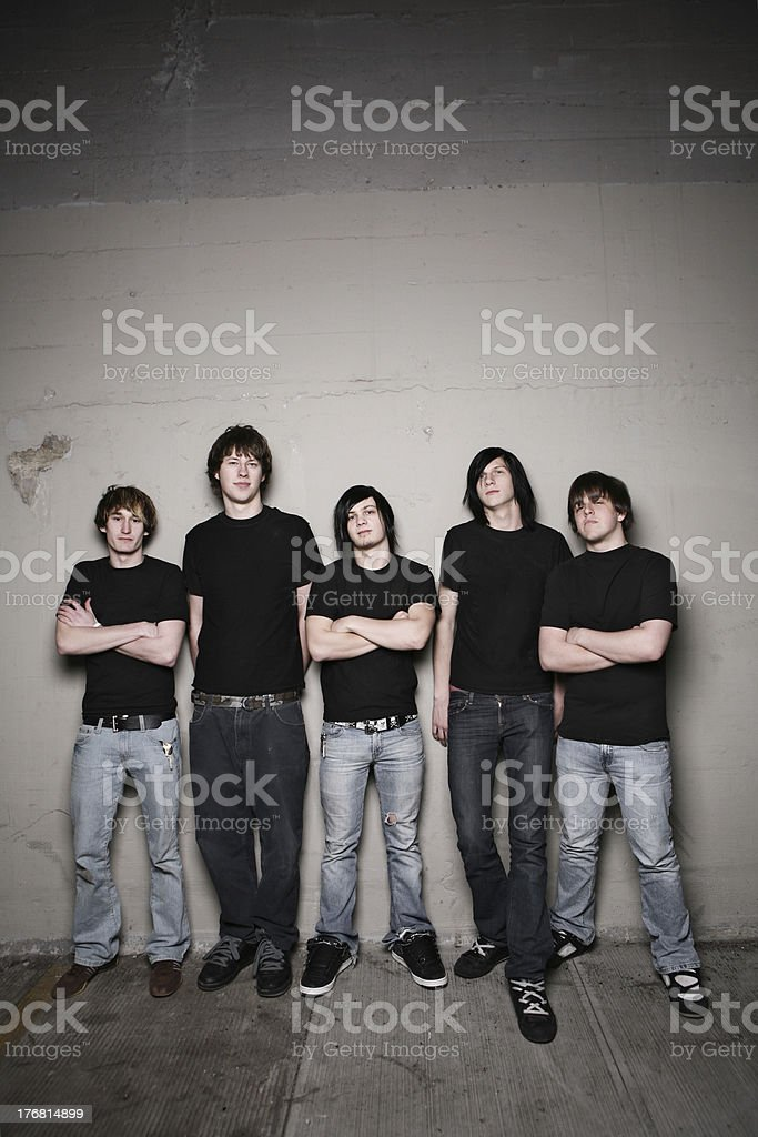 Group of Guys Against Wall royalty-free stock photo