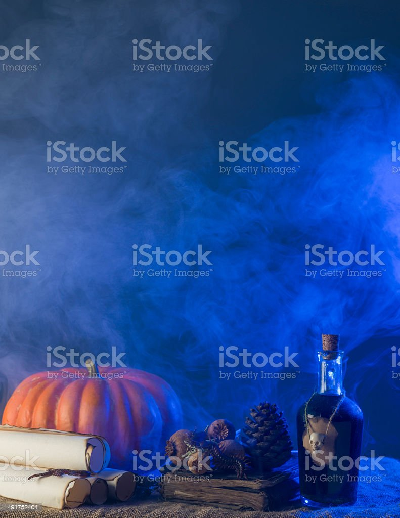 Group Of Halloween Objects Under Blue Fantastic Smoky Atmosphere stock photo