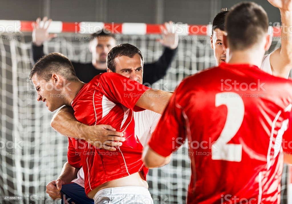 Group of handball players in action. royalty-free stock photo