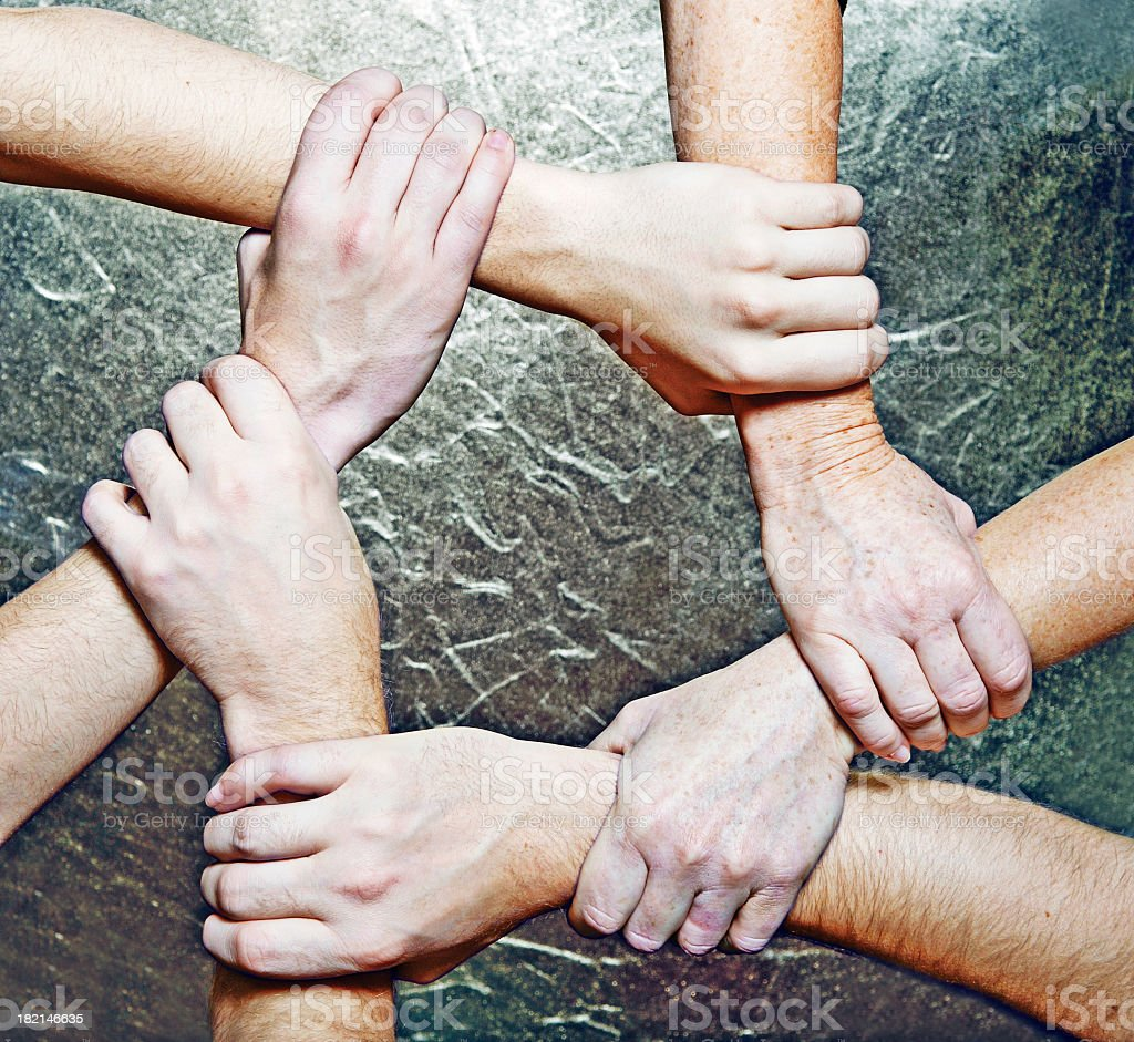 Group of hands connected to form star shape royalty-free stock photo