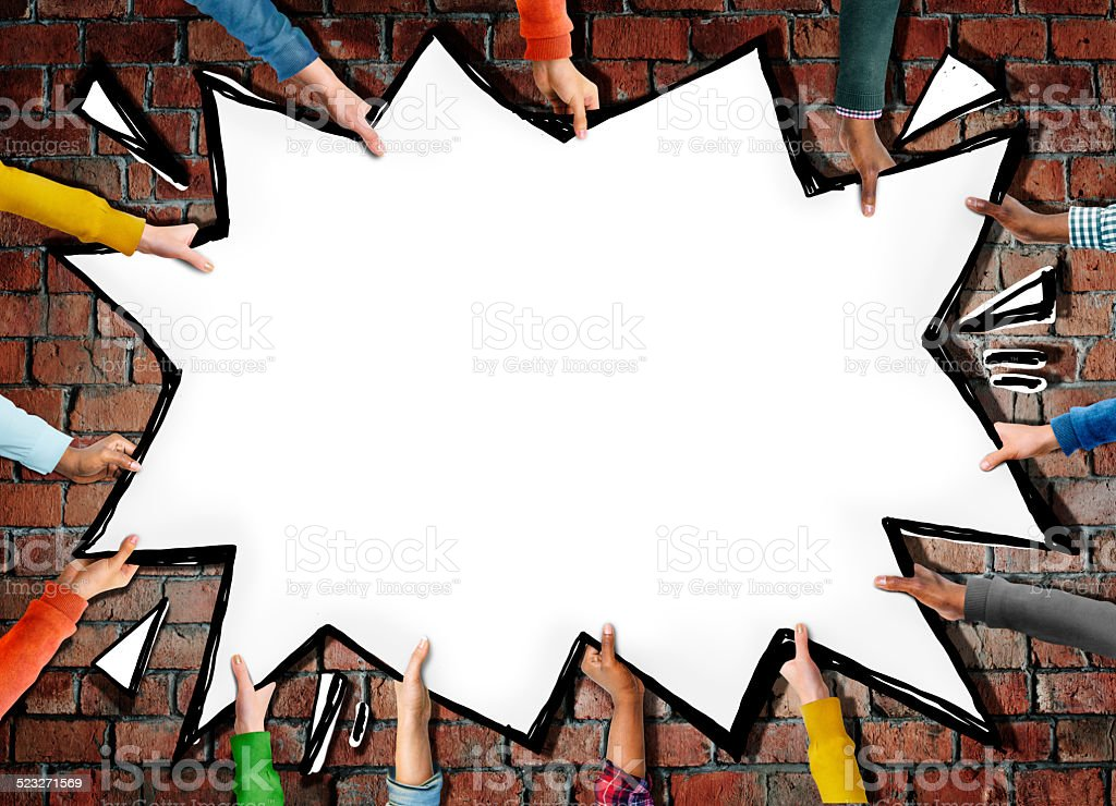 Group of Hands Holding Comic Explosion stock photo