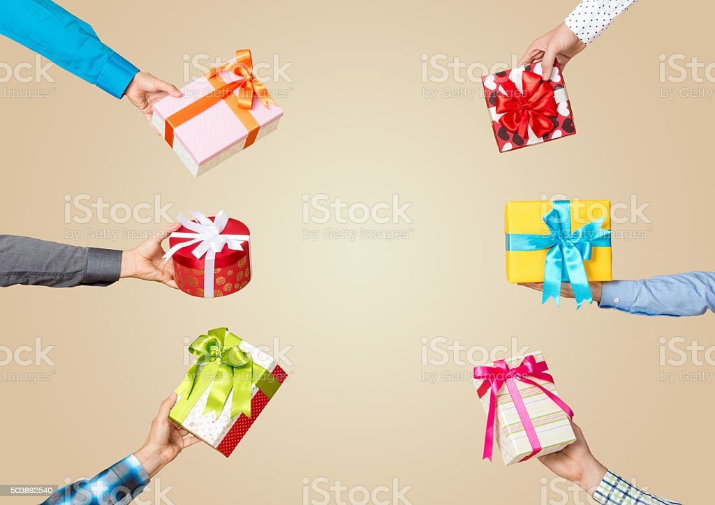Group of hands holding gift boxes stock photo