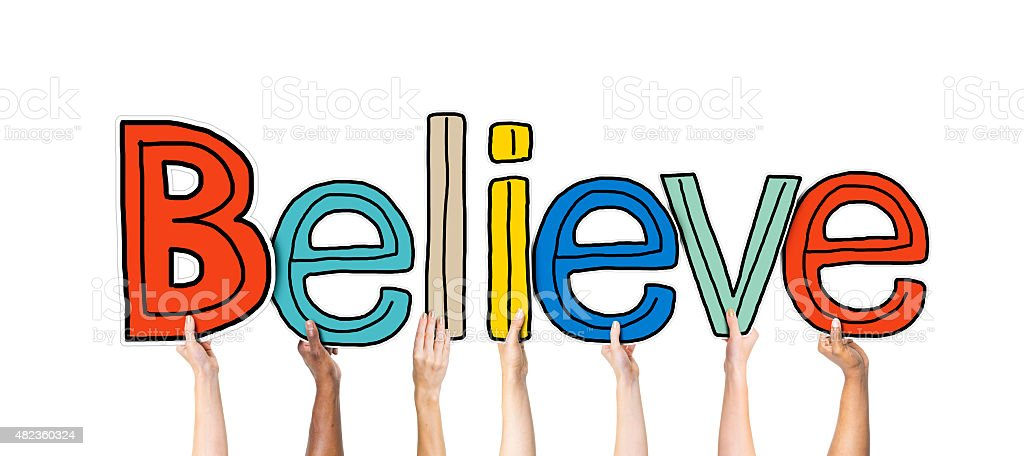 Group of Hands Holding Letter Believe stock photo