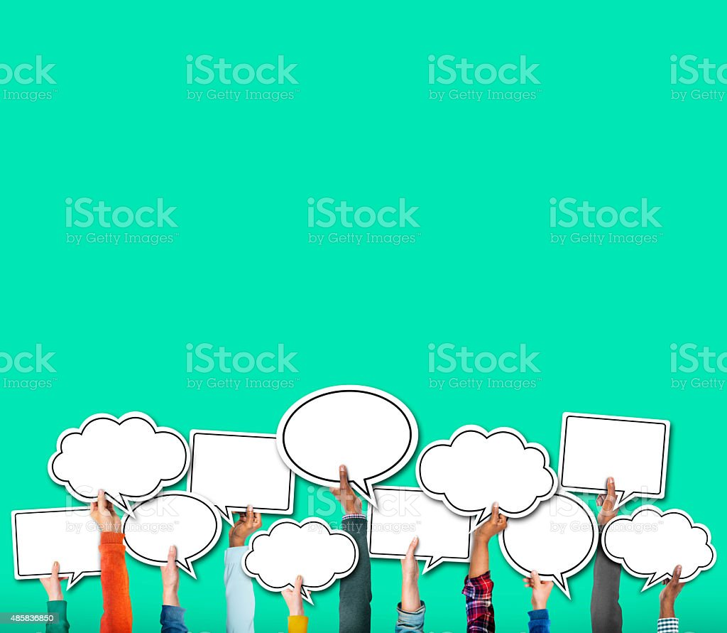 Group of Hands Holding Speech Bubble Concept stock photo